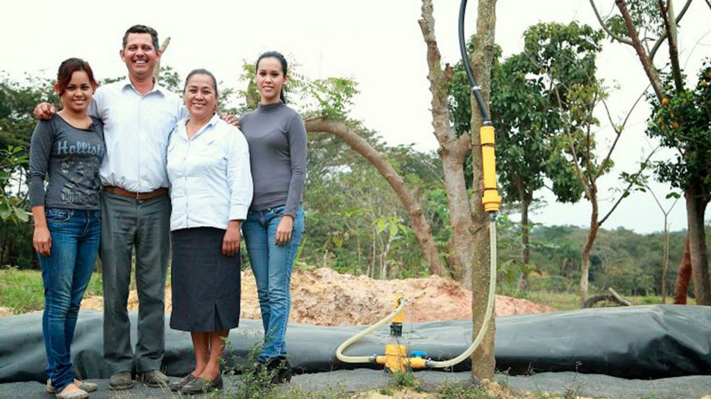 farmers and a biodigester